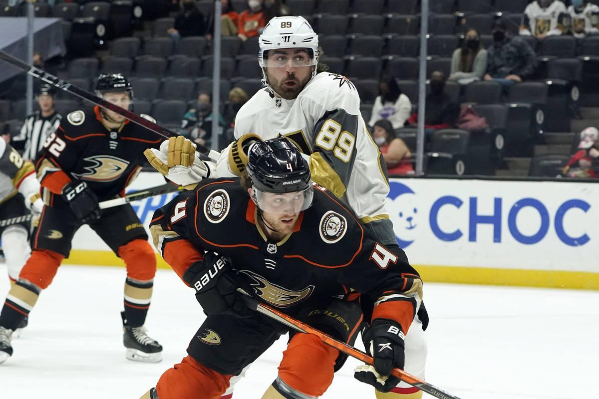 Anaheim Ducks defenseman Cam Fowler (4) defends on Vegas Golden Knights right wing Alex Tuch (8 ...