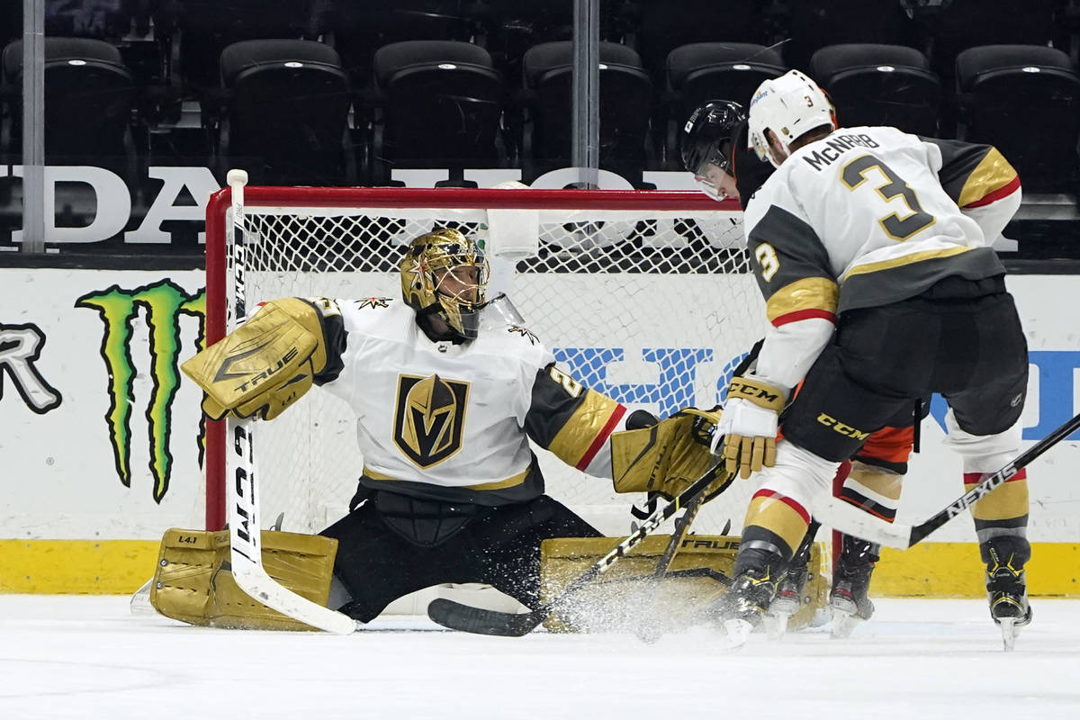 Vegas Golden Knights goaltender Marc-Andre Fleury stops a shot on goal during the first period ...