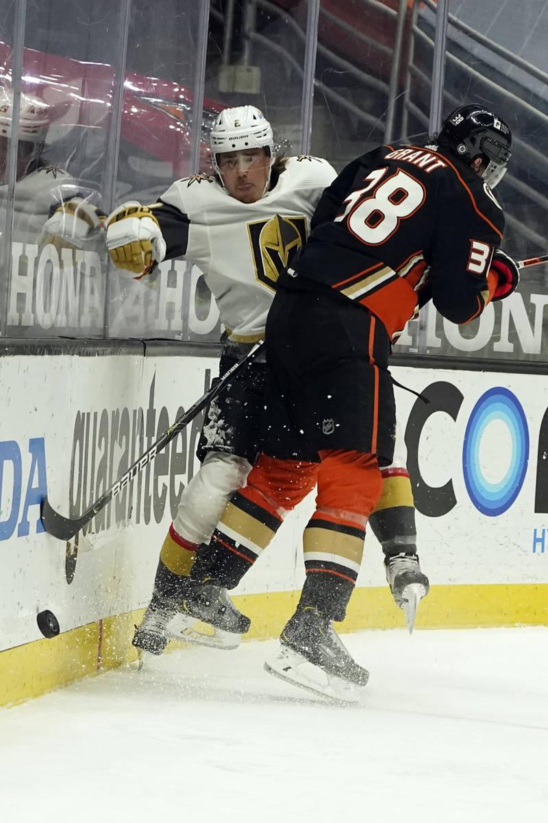Vegas Golden Knights defenseman Zach Whitecloud, right, collides with Anaheim Ducks center Dere ...