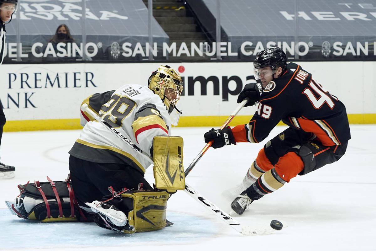 Vegas Golden Knights goaltender Marc-Andre Fleury, left, stops a shot from Anaheim Ducks left w ...