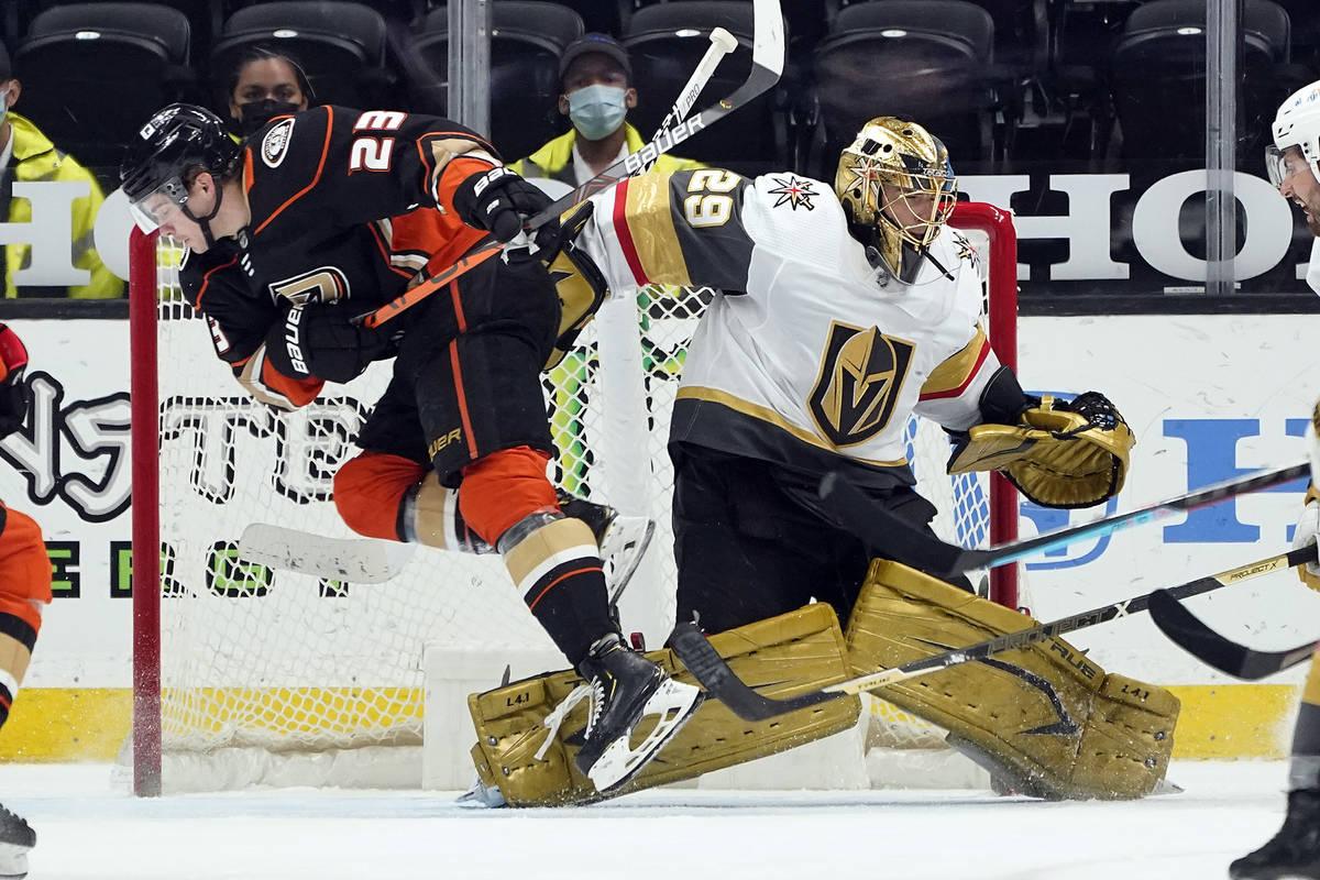 Anaheim Ducks' Sam Steel (23) collides with Vegas Golden Knights goaltender Marc-Andre Fleury ( ...