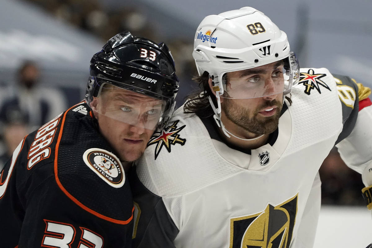 Vegas Golden Knights right wing Alex Tuch, right, is defended by Anaheim Ducks right wing Jakob ...