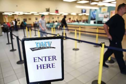 People walk through the line at the DMV office at 2701 E. Sahara Ave. in Las Vegas. (Las Vegas ...