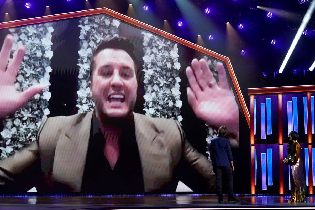 Luke Bryan appears on screen accepting the award for entertainer of the year at the 56th annual ...