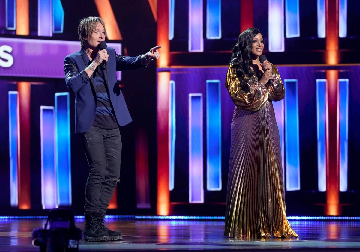 Hosts Keith Urban, left, and Mickey Guyton speak at the 56th annual Academy of Country Music Aw ...