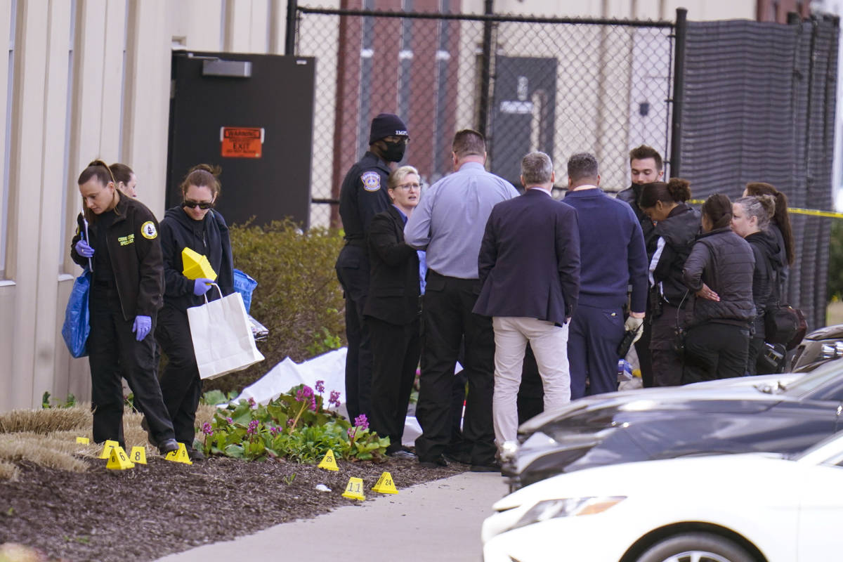 Authorities confer at the scene where multiple people were shot at the FedEx Ground facility ea ...
