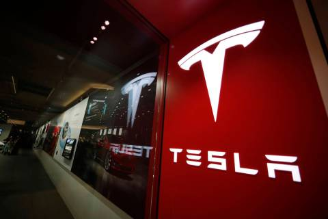 This Feb. 9, 2019, file photo shows a sign bearing the company logo outside a Tesla store in Ch ...