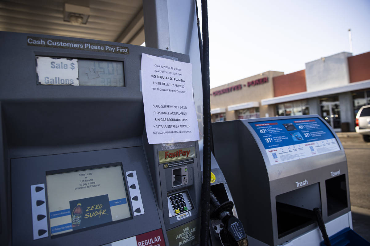 A sign stating that only supreme 91 and diesel gas is available is seen posted at a Chevron gas ...