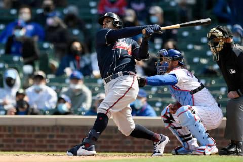 Atlanta Braves' Sean Kazmar Jr. bats during the fifth inning of a baseball game against the Chi ...