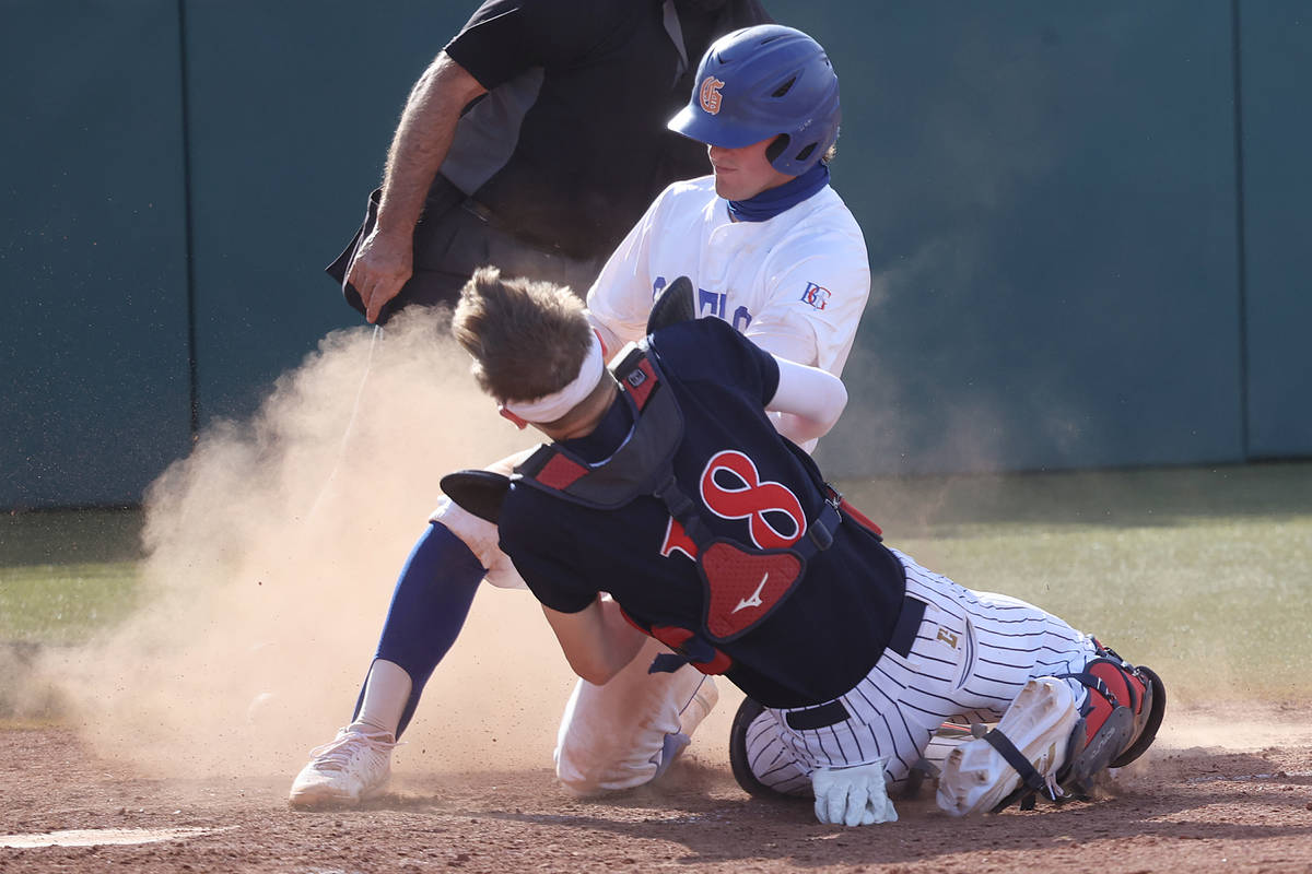 Coronado's catcher Caden Denning (18) tags Bishop Gorman's Demitri Diamant (5) for an out at ho ...