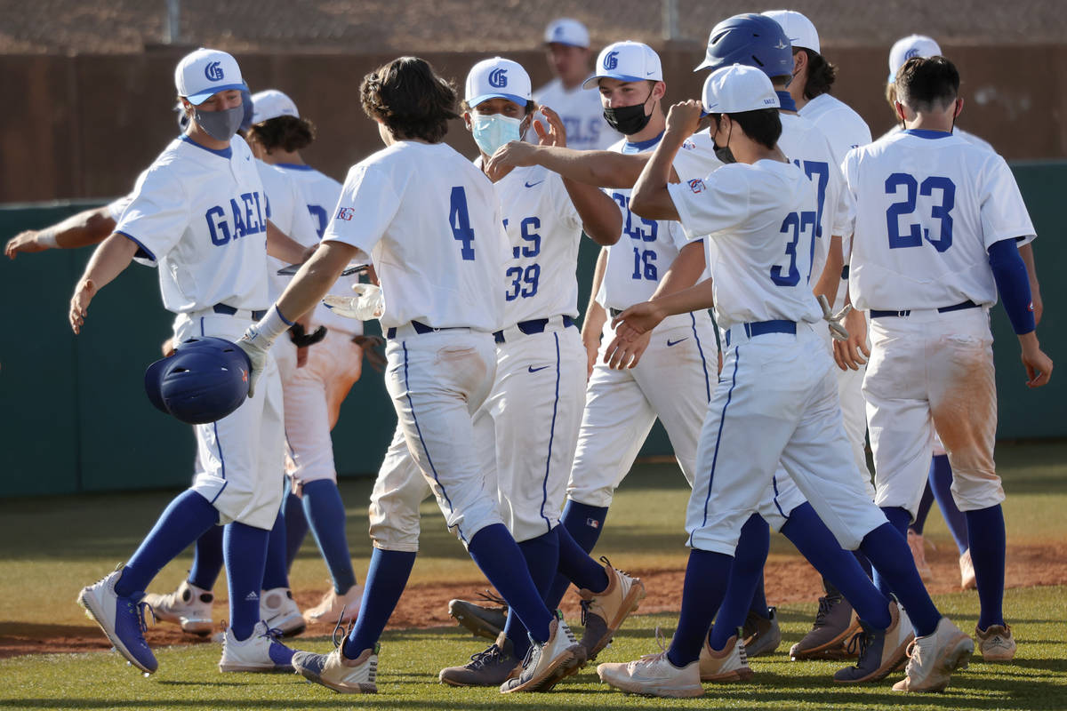 Bishop Gorman's Anthony Marnell (4) celebrates a walk-off hit with his team in the fifth inning ...