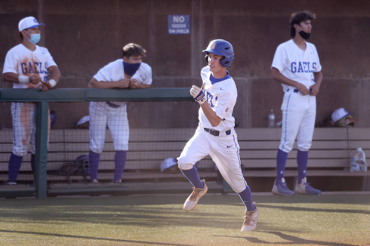 Bishop Gorman's Tommy Rose (23) runs home for a run in the fourth inning of the baseball game a ...