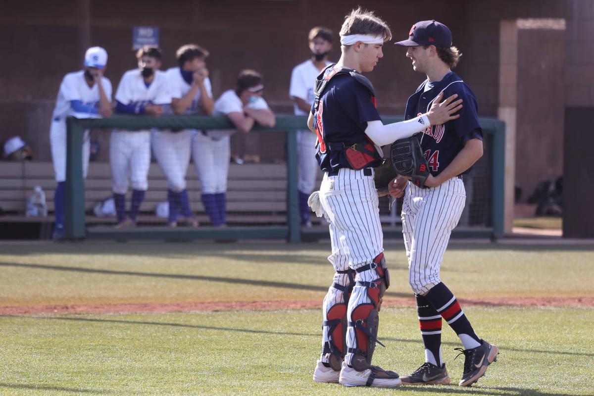 Coronado's catcher Caden Denning (18) takes a moment to talk to pitcher Jordan Writer (14) in t ...