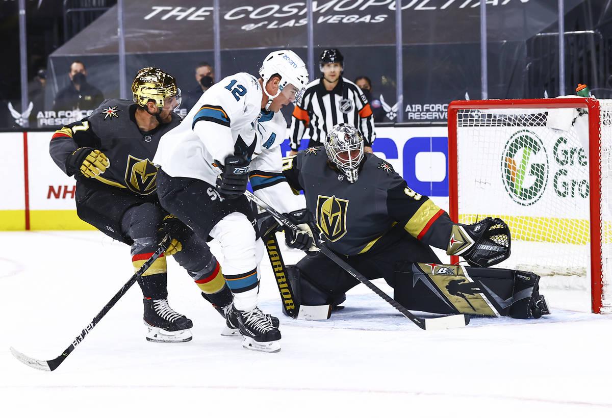 Golden Knights goaltender Robin Lehner (90) reaches out to block a shot from San Jose Sharks' P ...