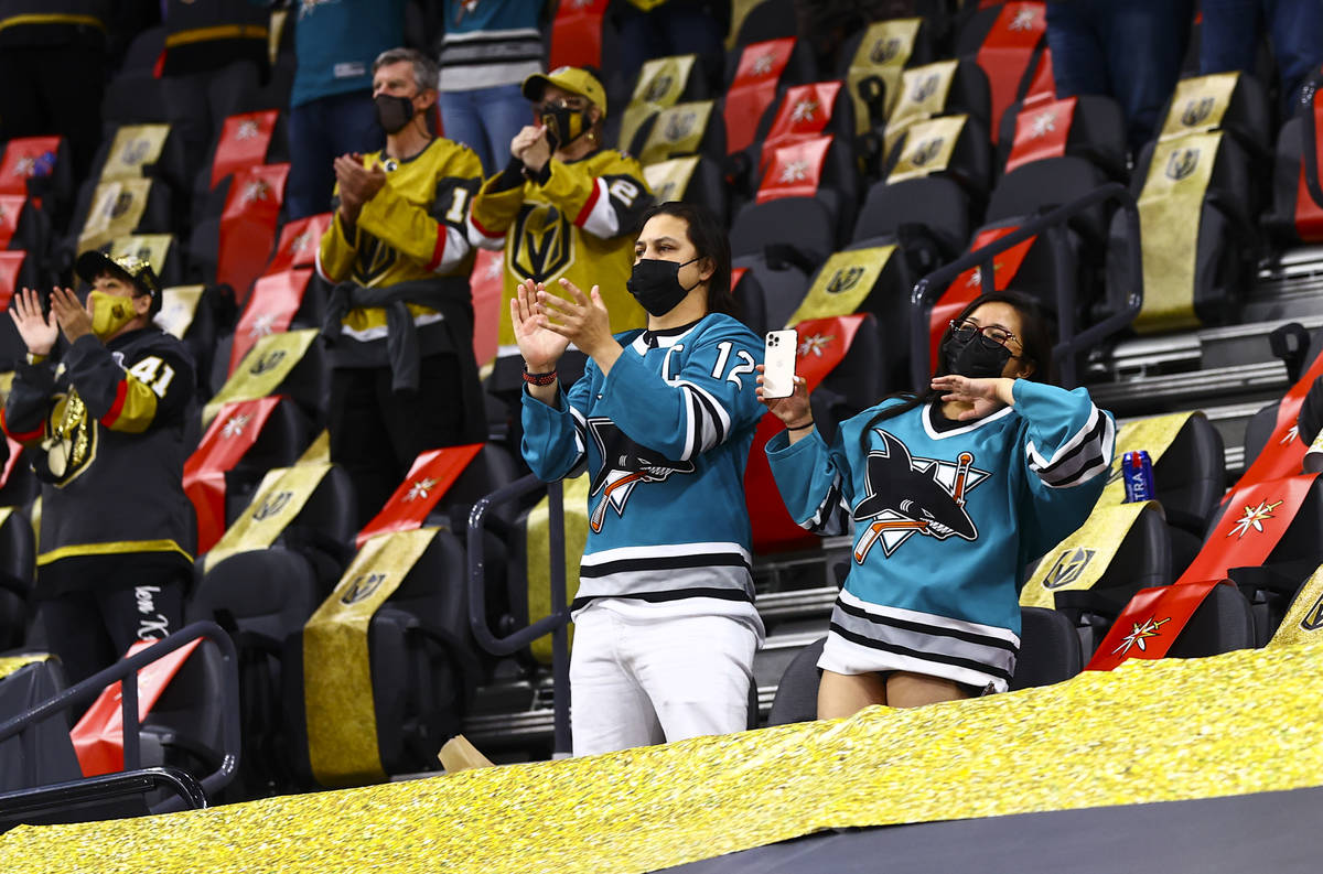 Hockey fans celebrate as San Jose Sharks' Patrick Marleau, not pictured, is honored in the 1,76 ...
