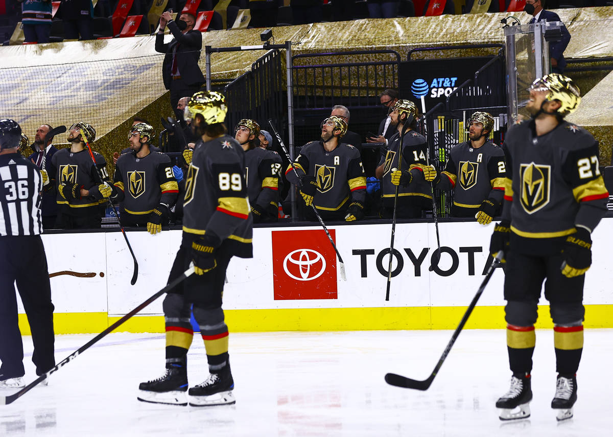 The Golden Knights tap their sticks as San Jose Sharks' Patrick Marleau, not pictured, is honor ...