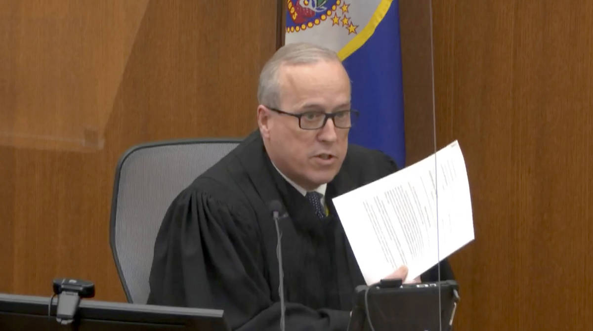 In this image from video, Hennepin County Judge PeterCahill reads instructions to the jur ...