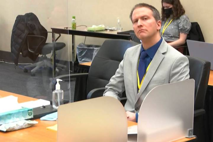 In this image from video, former Minneapolis police Officer Derek Chauvin listens as his defens ...