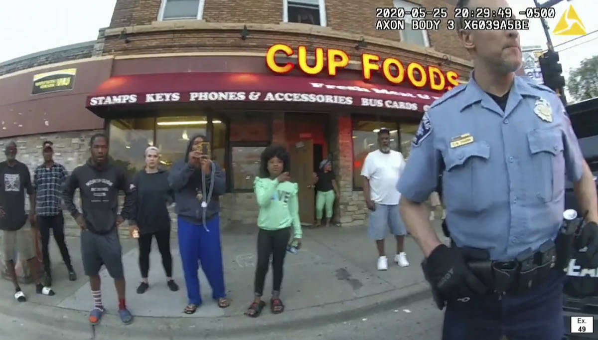 In this image from police body camera video former Minneapolis police Officer Derek Chauvin sta ...