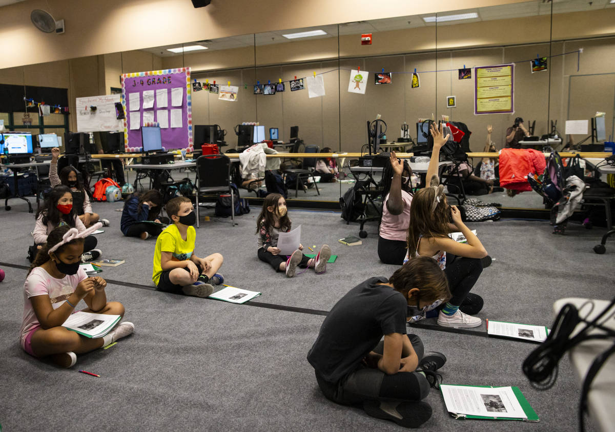 Students listen as learning guide Tammy Slank, not pictured, teaches during a third and fourth ...