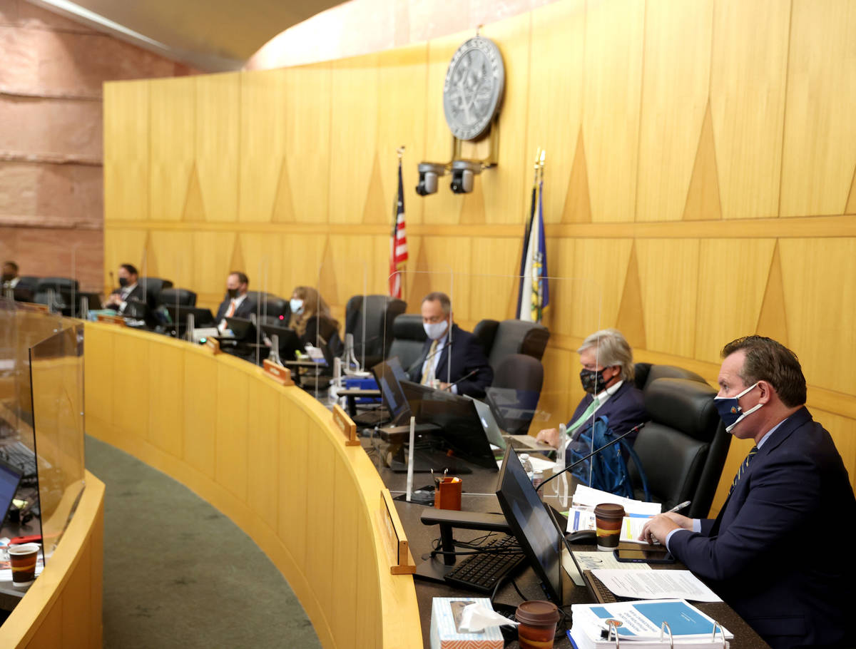 Clark County commissioners, including Ross Miller, right, during a commission meeting in Las Ve ...