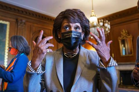 Rep. Maxine Waters, D-Calif., joins members of the Congressional Black Caucus to await the verd ...