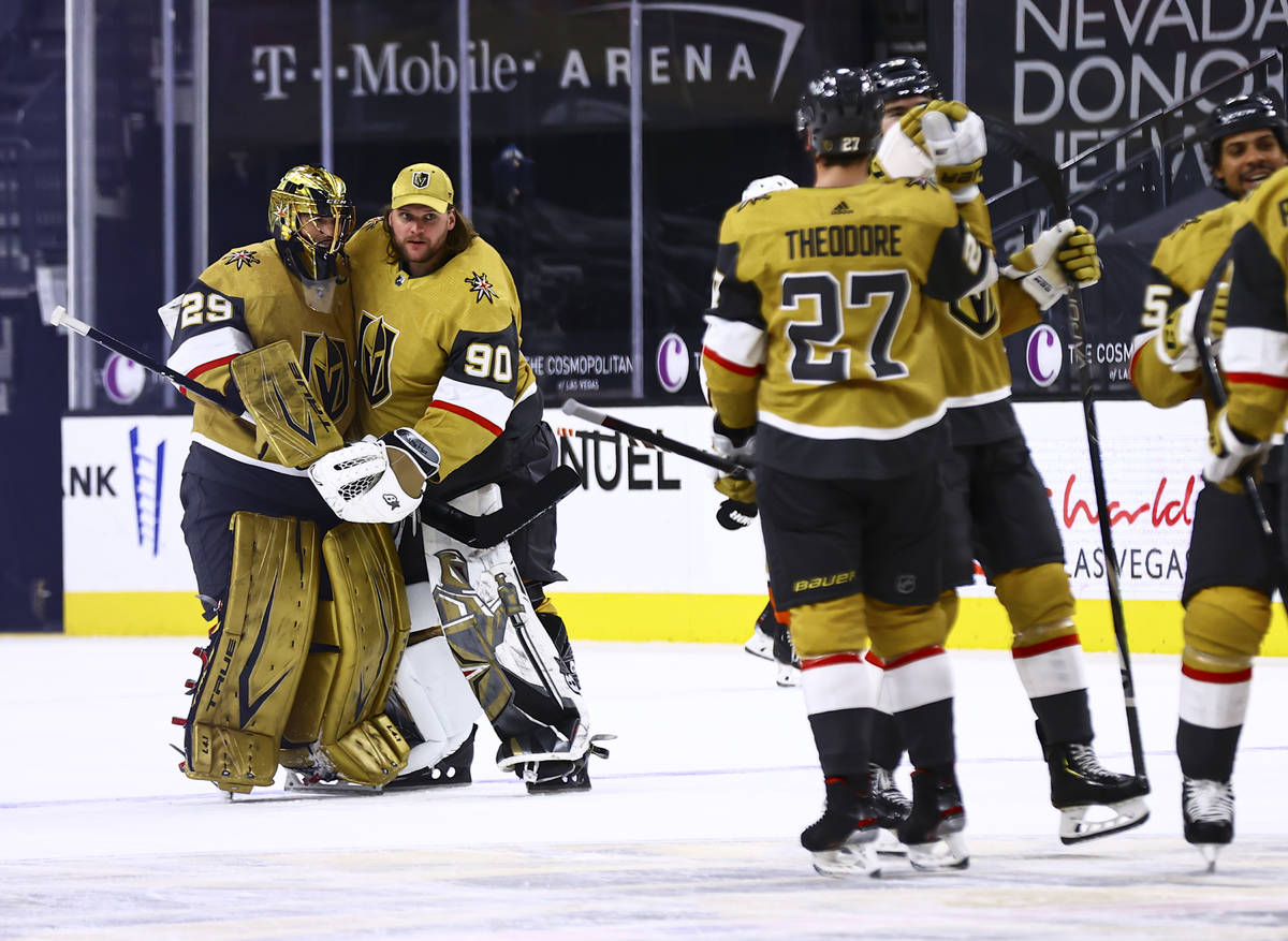Golden Knights goaltenders Marc-Andre Fleury (29) and Robin Lehner (90) celebrate after their o ...