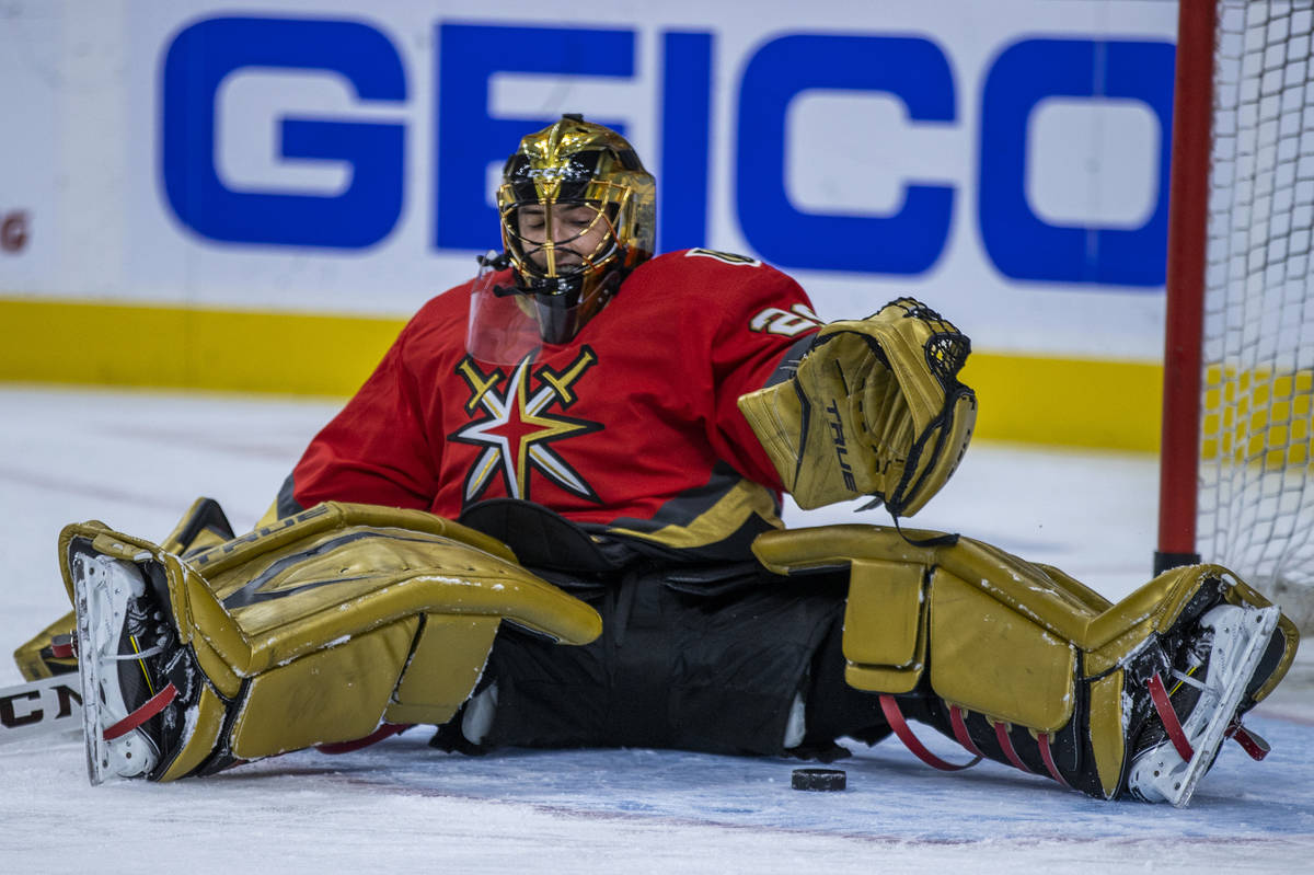 Golden Knights goaltender Marc-Andre Fleury (29) looks to a puck prior to the first period of a ...