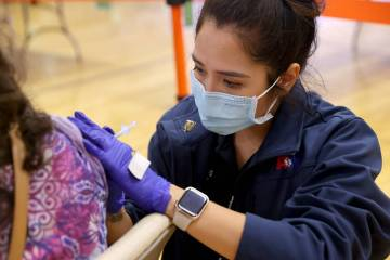 Ideco Flores, an Advanced Emergency Medical Technician with American Medical Response, vaccinat ...