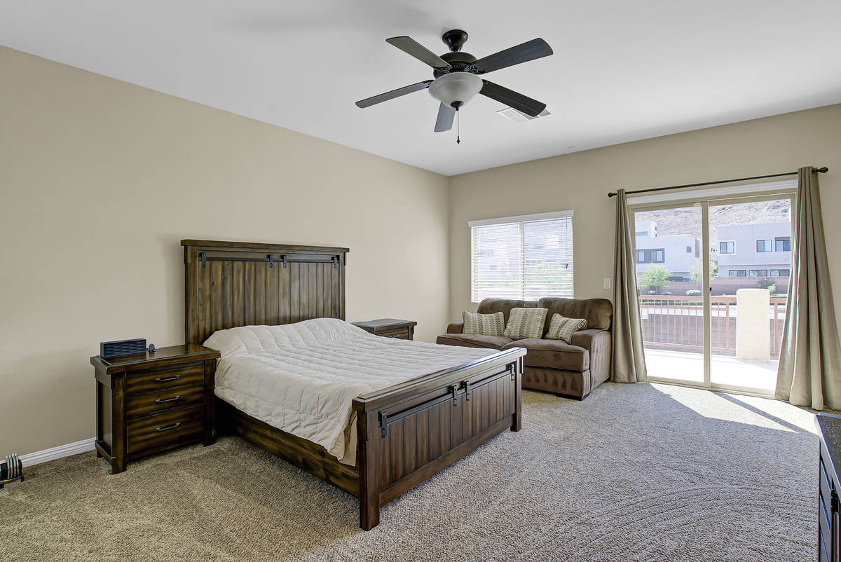 The primary bedroom at 837 Motherwell Ave. in Henderson looks out onto a balcony. (Casie and D ...
