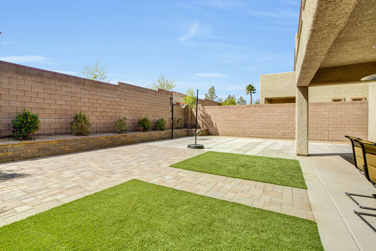 The rear yard (and basketball-ready area) of 837 Motherwell Ave. in Henderson (Casie and Derek ...