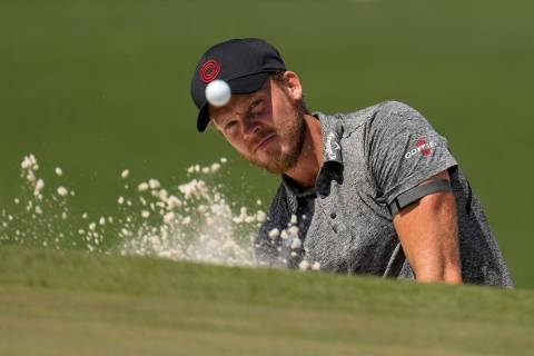 Danny Willett, of England, hits from the bunker on the seventh hole during a practice round for ...