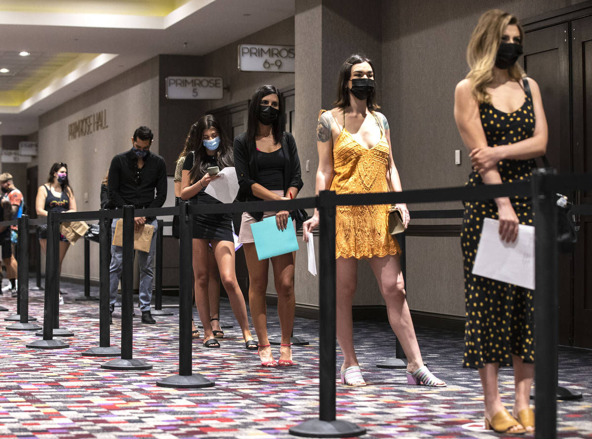 Job seekers line up to apply for jobs at Virgin Hotels Las Vegas, on Thursday, April 22, 2021, ...