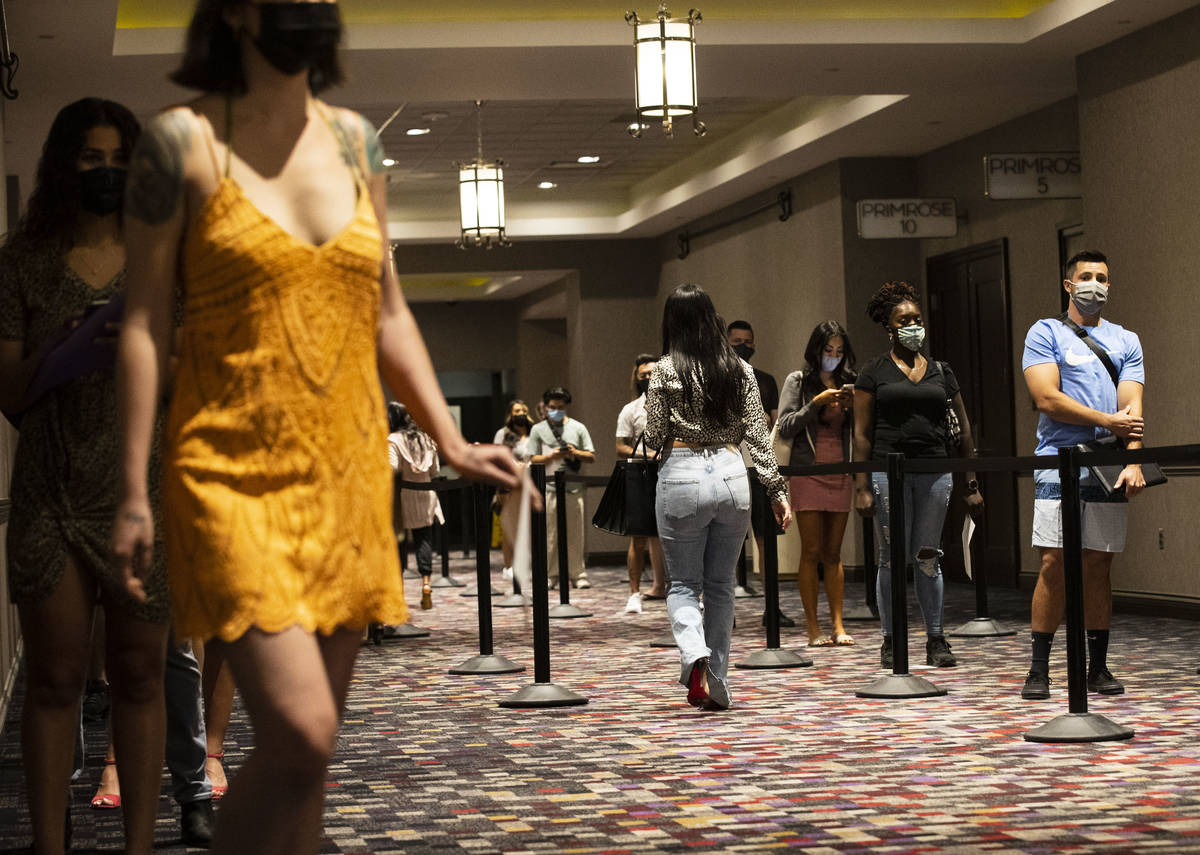 Job seekers line up to apply for jobs at Virgin Las Vegas, on Thursday, April 22, 2021, in Las ...