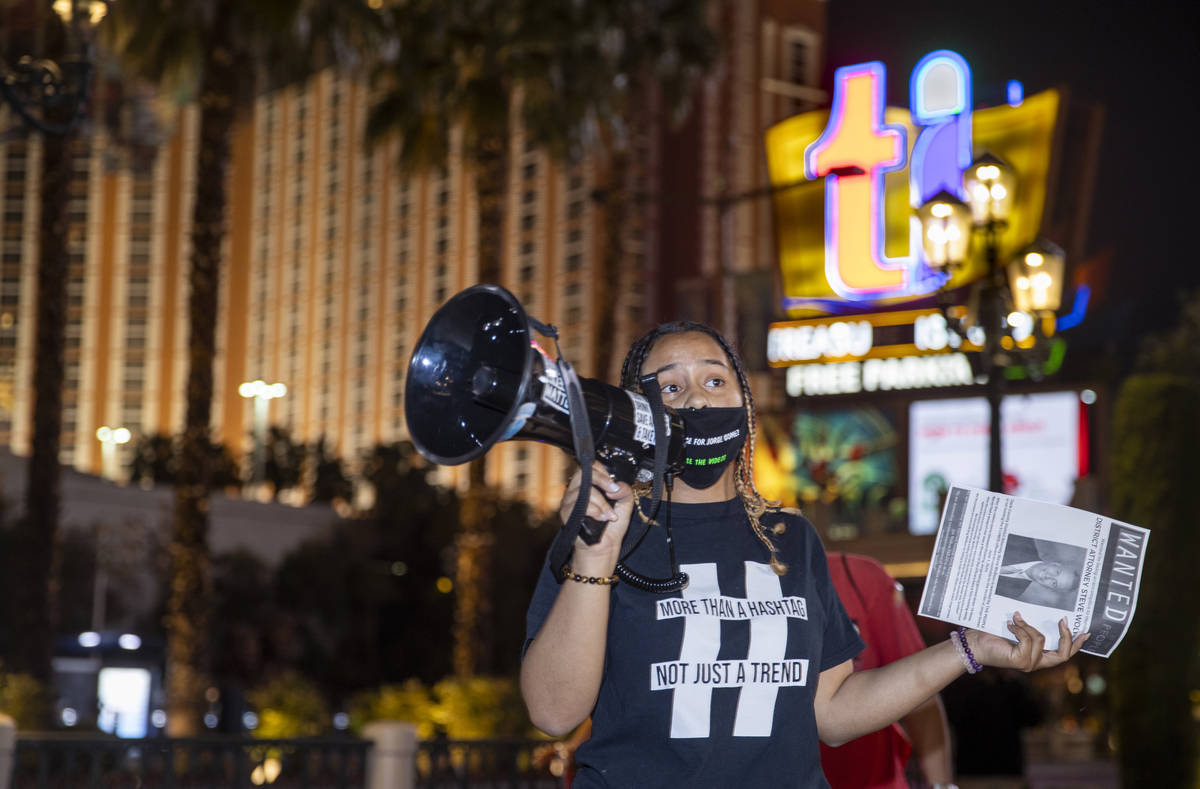 Organizer Desiree Smith talks to the small gathering before they leave the Venetian to march al ...