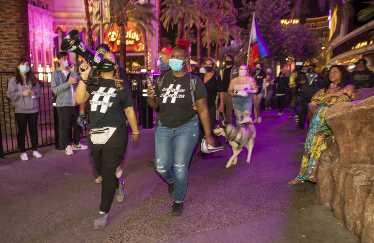 Organizer Desiree Smith, left, and a small group march along the Strip following the conviction ...