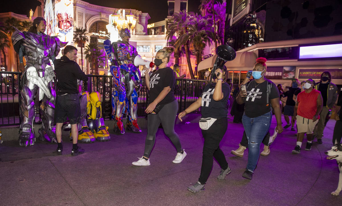 Organizers Leinati Hackley, left and Desiree Smith lead a small group march along the Strip fol ...