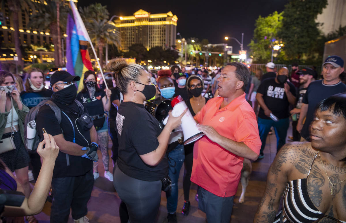 Organizer Leinati Hackley, left gets into a minor altercation with a visitor along the Strip fo ...