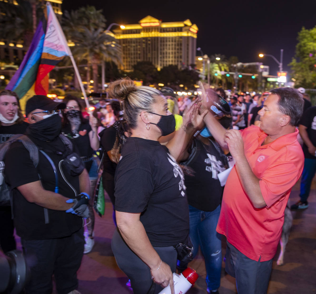 Organizer Leinati Hackley, left gets into a minor altercation with a visitor along the Strip du ...