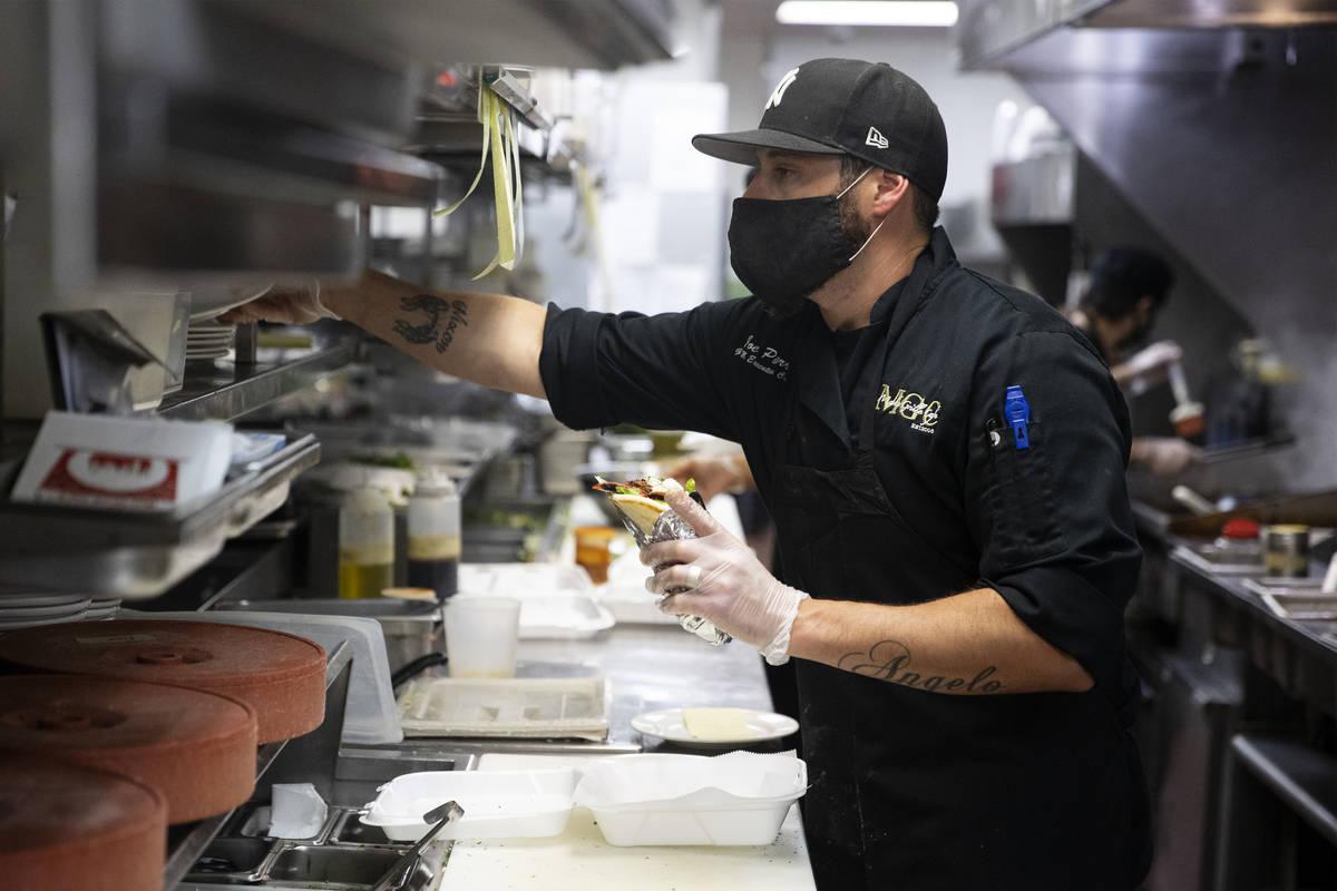 Joe Pierro Jr., the son of Market Grille Cafe owner Joe Pierro, works on an order during lunch ...