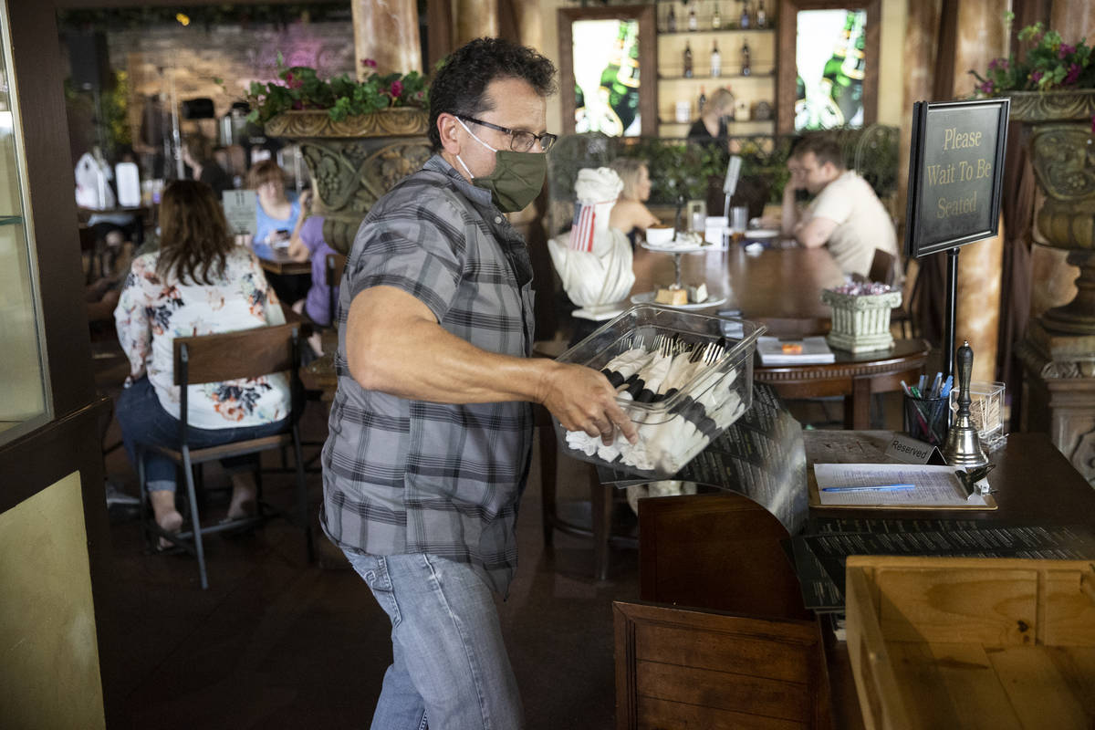 Joe Pierro, owner of Market Grille Cafe, works the host desk at his restaurant. Before the pand ...