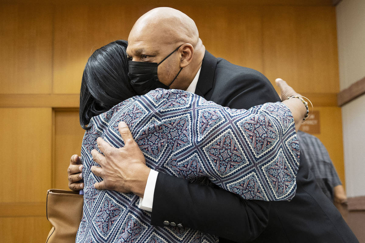 Former NBA player Jackie Robinson hugs his sister Judy Robinson after the Clark County Commissi ...