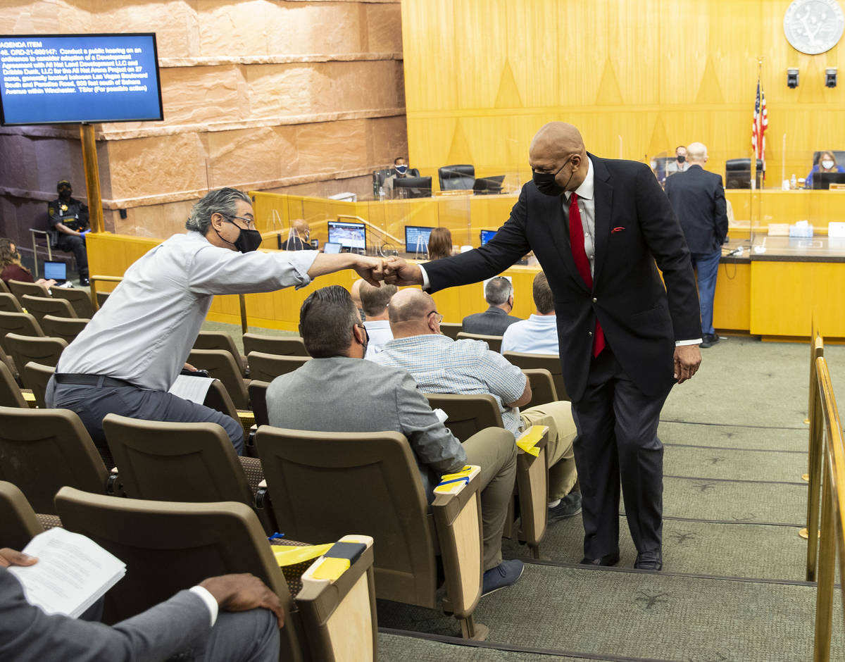 Former NBA player Jackie Robinson exchanges fist bumps with supporters inside commission chambe ...