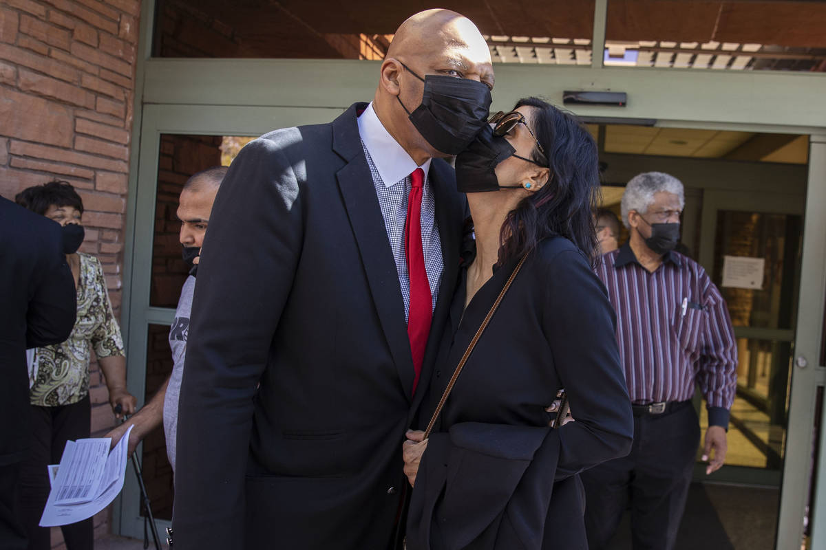 Former NBA player Jackie Robinson embraced by his wife Maria after the Clark County Commission ...