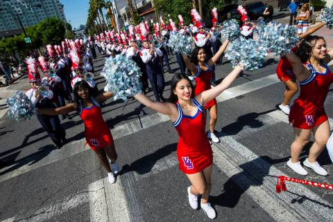 Members of the Valley High School marching band and cheer perform during the Helldorado Parade ...