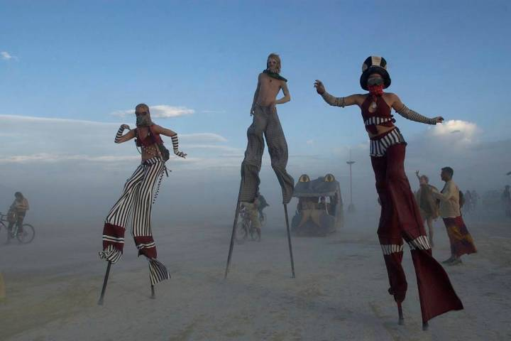FILE - In this Sept. 2, 2004 file photo stilt walkers enjoy a sunset stroll at the Burningman c ...