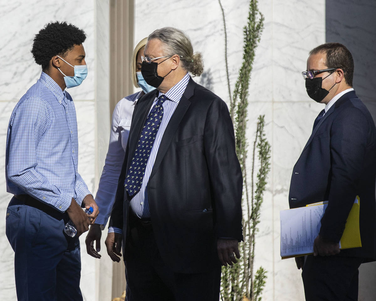 Former Bishop Gorman High School basketball standout Zaon Collins, left, talks with his attorne ...