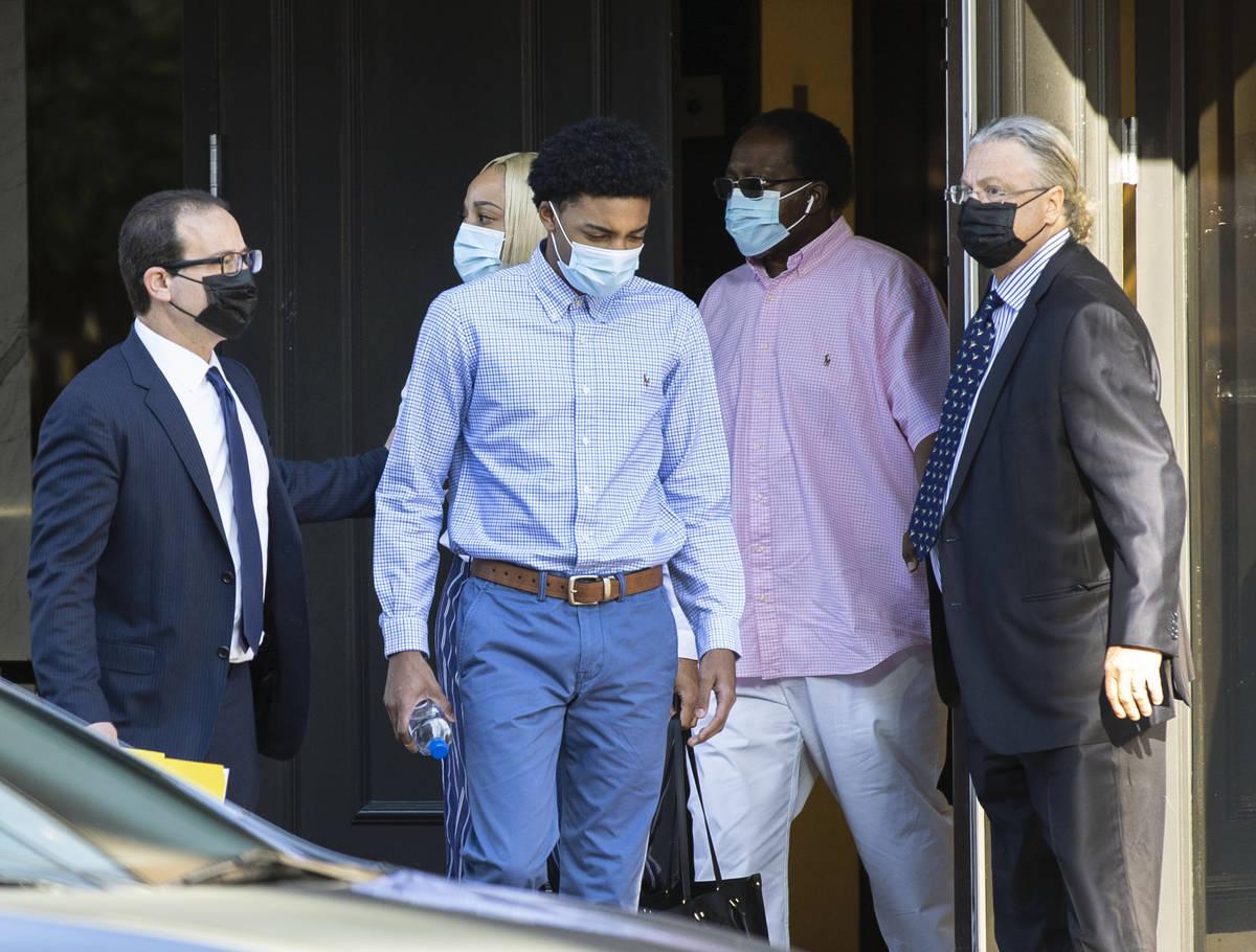Bishop Gorman High School basketball standout Zaon Collins, center, leaves his attorneys office ...