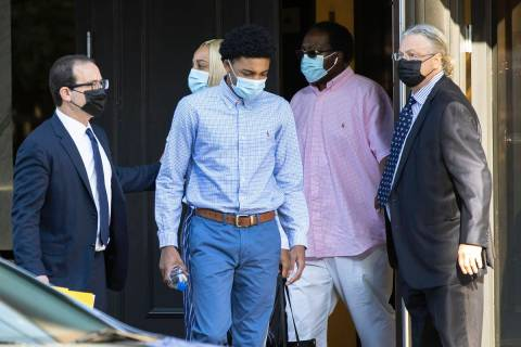Former Bishop Gorman High School basketball standout Zaon Collins, center, leaves his attorneys ...