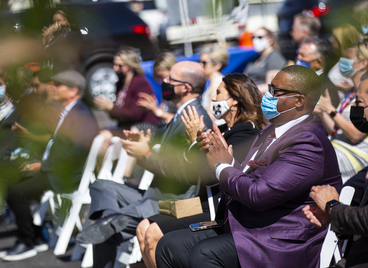 Las Vegas City Councilman Cedric Crear, right, claps during the opening ceremony for the $56 mi ...